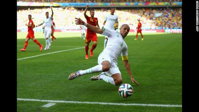 Algeria's Madjid Bougherra reaches for the ball.