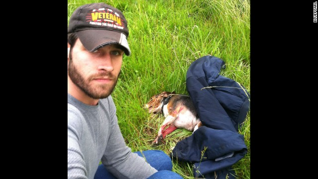 Aaron Schneider, an Iraq War veteran, snapped this shot after he rescued a beagle that he saw get hit by a car on Interstate 470 in Lee's Summit, Missouri. Schneider crossed several lanes of traffic to get the dog to safety, and he later took it to get medical care, <a href='http://www.kmbc.com/news/iraq-war-veteran-saves-dog-hit-by-car-along-i470/26484176#!0c192' target='_blank'>according to KMBC.</a> The dog was expected to recover from its injuries.