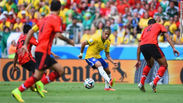 Neymar of Brazil looks to find a way through the Mexican defense.