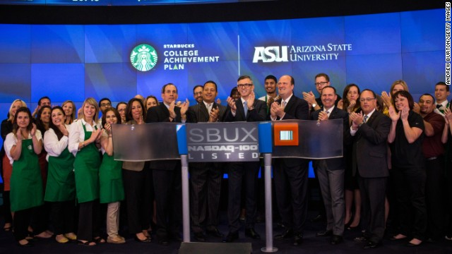 Starbucks executives applaud the company's partnership with Arizona State University at the opening bell of the Nasdaq Stock Exchange on June 17.