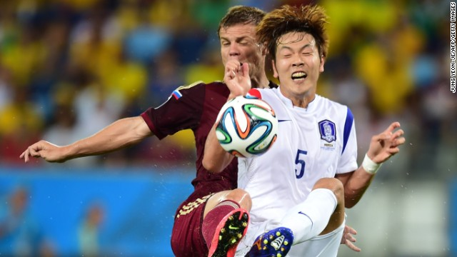 Russian forward Alexander Kokorin, left, vies with South Korean defender Kim Young-Gwon.