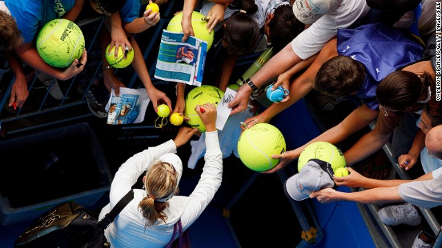 Fans scramble for an autograph from Sharapova at the 2008 Australian Open. She won in the final against Ana Ivanovic, having not dropped a set all tournament.
