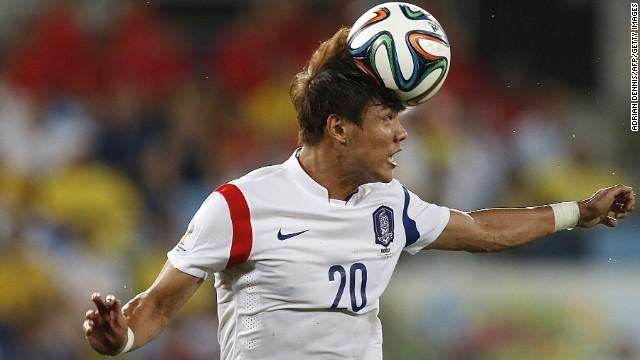 South Korean defender Hong Jeong-Ho heads the ball.