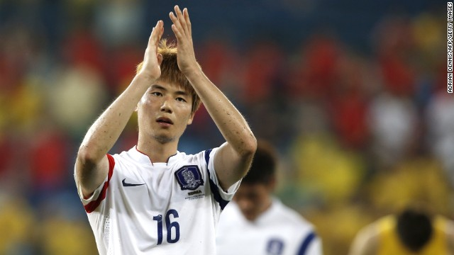 South Korean midfielder Ki Sung-Yueng applauds after his team's match against Russia during the World Cup on Tuesday, June 17, in Cuiaba, Brazil. The game ended 1-1.