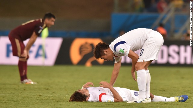 South Korean defender Hwang Seok-Ho, right, approaches a teammate at the end of the game.