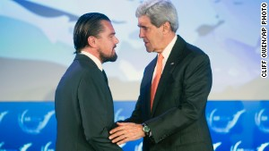 Secretary of State John Kerry talks with actor Leonardo DiCaprio after they both spoke at the second day of the State Department\'s \'Our Ocean\' conference in Washington.