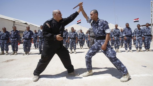 Newly recruited Iraqi volunteer fighters take part in a training session in Karbala on June 17.