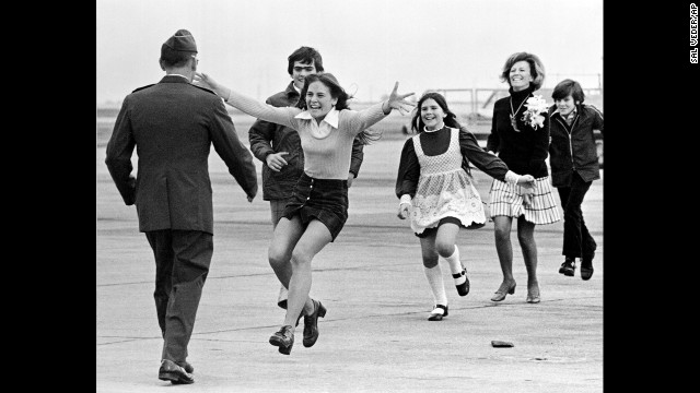 "Newly freed U.S. prisoner of war Air Force Lt. Col. Robert L. Stirm is greeted by his family at Travis Air Force Base in Fairfield, California, in 1973. This Pulitzer Prize-winning photograph, named Burst of Joy, was taken by Associated Press photographer Sal Veder. ""You could feel the energy and the raw emotion in the air,""<a href='http://www.smithsonianmag.com/history/coming-home-106013338/?no-ist=' target='_blank'> Veder told Smithsonian Magazine in 2005. </a>"