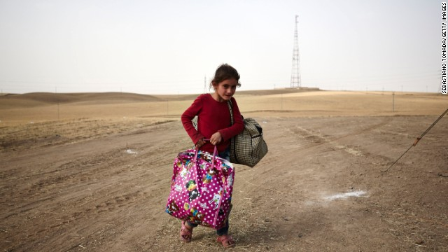 A girl fleeing from Mosul arrives at a Kurdish checkpoint on June 12.