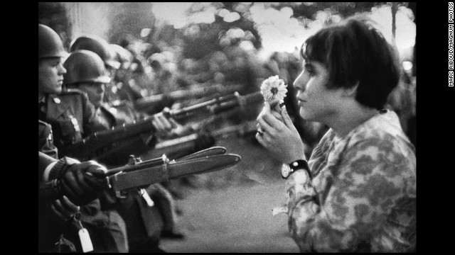 "Frenchman Marc Riboud captured one of the most well-known anti-war images in 1967. Jan Rose Kasmir confronts National Guard troops outside the Pentagon during a protest march. The photo helped turn public opinion against the war. ""She was just talking, trying to catch the eye of the soldiers, maybe try to have a dialogue with them,"" <a href='http://www.smithsonianmag.com/history/flower-child-102514360/' target='_blank'>recalled Riboud in the April 2004 Smithsonian magazine,</a> ""I had the feeling the soldiers were more afraid of her than she was of the bayonets."""