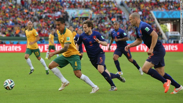Australia's Tim Cahill dribbles past Dutch players. Cahill had a tremendous volley in the first half to tie the game at 1-1.