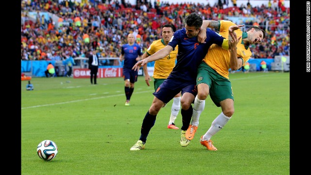 Van Persie fights off Matthew Spiranovic of Australia.