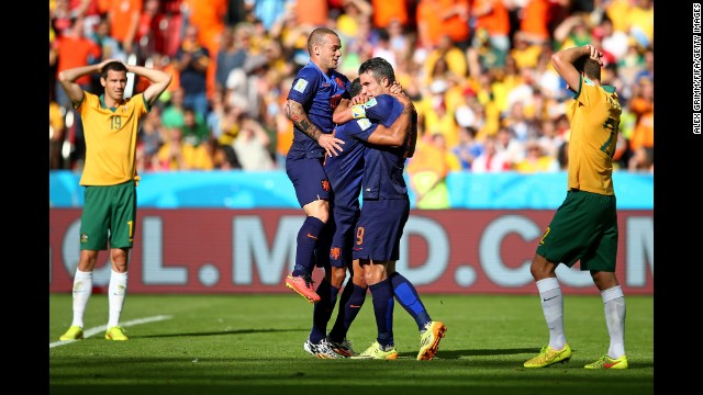 Depay, center, is hugged by teammate Robin Van Persie after he scored what proved to be the match-winning goal.