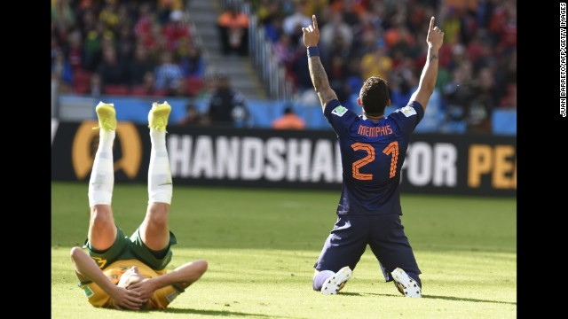 Netherlands forward Memphis Depay celebrates at the end of his team's World Cup match against Australia. Depay's second-half goal was the difference as the Netherlands won 3-2 in Porto Alegre, Brazil.