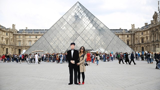 """I consider myself an artist, and when I set out on this mission I wanted to honor my father's memory and take beautiful photos,"" says Yang, who visited the Louvre (pictured) in Paris."