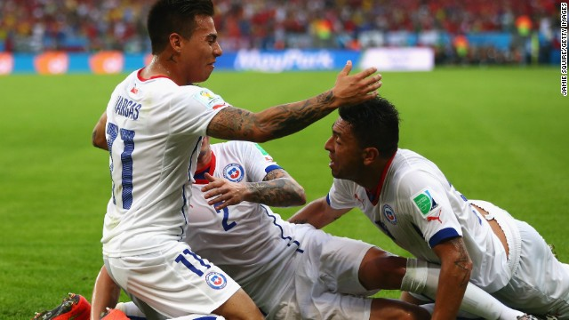 "South and North American teams have warmed to Brazil 2014, with a host of nations exceeding expectations. Chile has led the way, escaping the ""Group of Death"" after defeating Australia and reigning champions Spain."