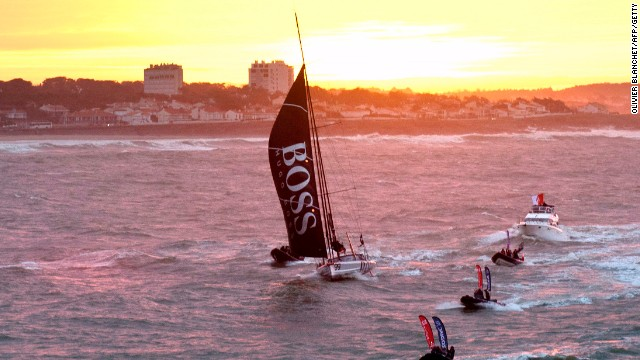Thomson comes into Les Sables D'Olonne harbor with an escort of small boats in 2012 after finishing third in the seventh edition of the Vendee Globe race.