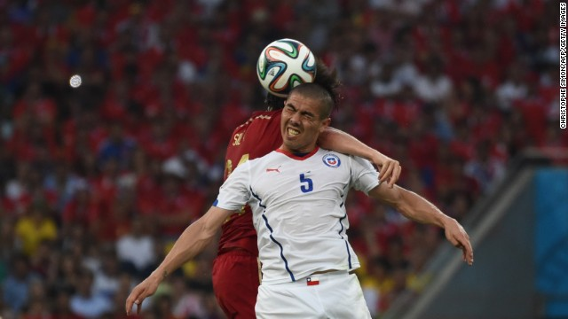 Spain midfielder David Silva, left, and Chile midfielder Francisco Silva compete for the ball.