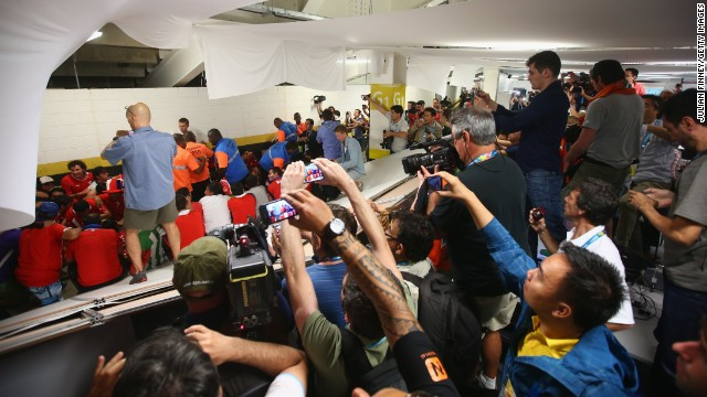 Security personnel attempt to control Chilean fans who <a href='http://bleacherreport.com/articles/2101732-chile-fans-break-into-maracana-press-room-before-world-cup-match-vs-spain' target='_blank'>invaded the press room</a> at the Maracana Stadium before the match.