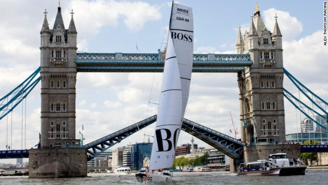 Thomson's Hugo Boss monohull yacht against the imposing backdrop of London's historic Tower Bridge.