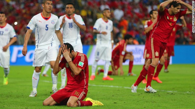 Spain's Sergio Busquets reacts after missing a golden chance for a goal in the second half.