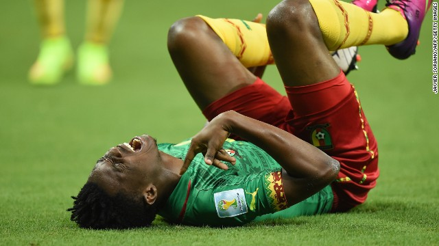 Cameroonian forward Benjamin Moukandjo screams as he lies on the pitch during the game.