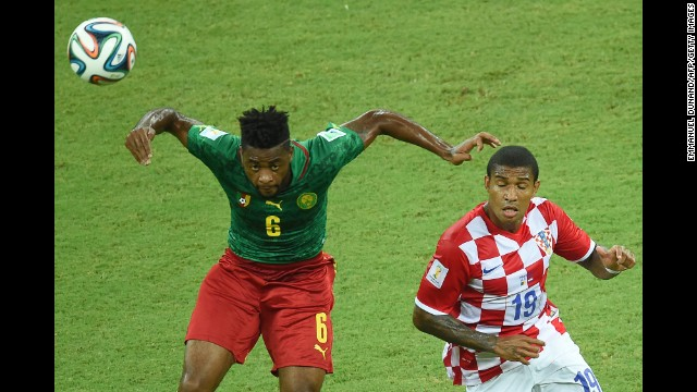Cameroon's Alexandre Song vies for the ball with Croatia's Sammir.