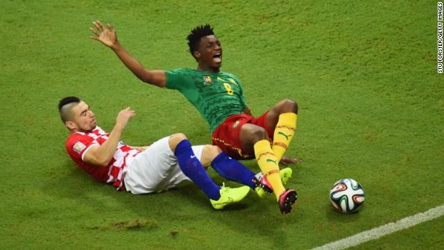 Danijel Pranjic of Croatia tackles Cameroon's Benjamin Moukandjo.