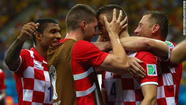 Ivan Perisic of Croatia, second from right, celebrates with teammates after scoring his team's second goal.