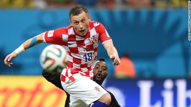 Cameroon's goalkeeper Charles Itandje, right, watches Croatia's Ivica Olic control the ball.