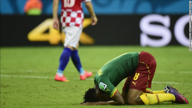 Cameroon's Benjamin Moukandjo, right, reacts during the game.