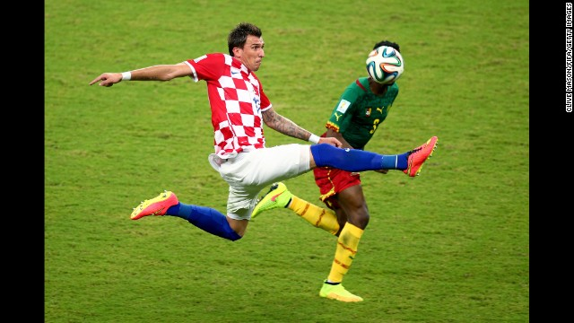 Mario Mandzukic of Croatia takes on Cameroon's Nicolas N'Koulou.