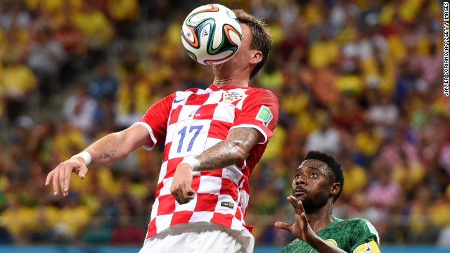 Croatia's Mario Mandzukic controls the ball in front of Cameroon's Nicolas Nkoulou.