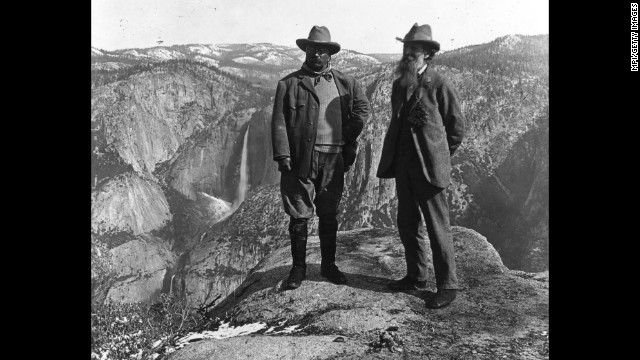 "<a href='http://www.nps.gov/thro/historyculture/theodore-roosevelt-and-conservation.htm' target='_blank'>President Theodore Roosevelt</a>, left, and conservationist and Sierra Club founder John Muir stand on Yosemite National Park's Glacier Point in 1903. After camping in the wilderness, Roosevelt wrote: ""It was like lying in a great solemn cathedral, far vaster and more beautiful than any built by the hand of man."""