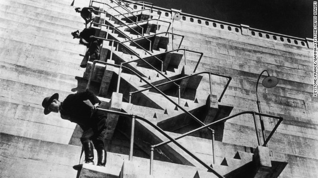 Yosemite National Park guards climb the staircase leading to the outlet valves of the O'Shaughnessy Dam, which was authorized by Congress in 1913 and completed in 1938. <a href='http://www.nps.gov/yose/planyourvisit/upload/hetchhetchy-sitebull.pdf' target='_blank'>The Hetch Hetchy Reservoir</a>, now the largest single body of water in the park, still provides water to residents of San Francisco and the Bay Area.
