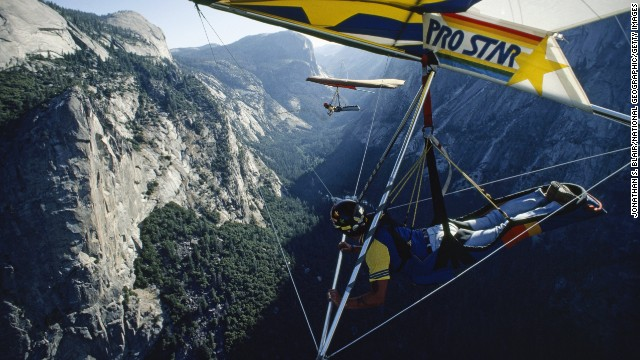 Hang gliders take off over Yosemite Valley from Glacier Point, circa 1985. <a href='http://parkplanning.nps.gov/projectHome.cfm?parkID=347&projectID=21599' target='_blank'>Only advanced rated hang gliding pilots</a> are permitted to fly in the park.
