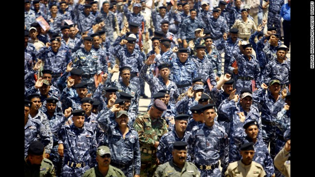 New army recruits gather in Najaf, Iraq, on Wednesday, June 18, following a call for Iraqis to take up arms against Islamic militant fighters.