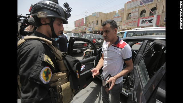Soldiers with an Iraqi anti-terrorism unit are on guard June 18 in Baghdad.