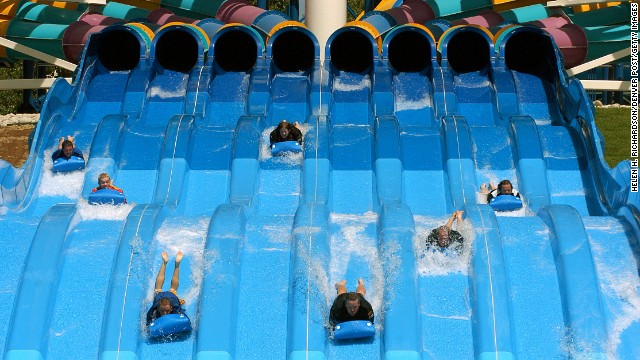 On Hyland Hills Water World's Turbo Racer (shown here) in Denver, Colorado, riders start headfirst, belly-down on a thin mat, dashing down an eight-lane, racetrack slide. The park was the ninth most visited water park in 2013.
