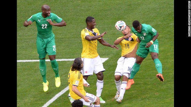 Zuniga, second from right, goes for a header along with Ivory Coast defender Serge Aurier.