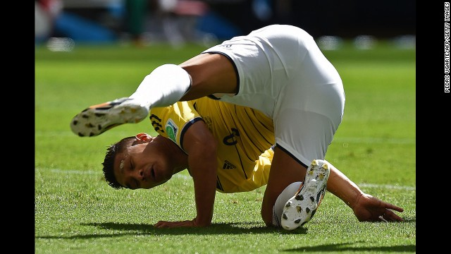 Colombian forward Teofilo Gutierrez falls to the ground in the first half.