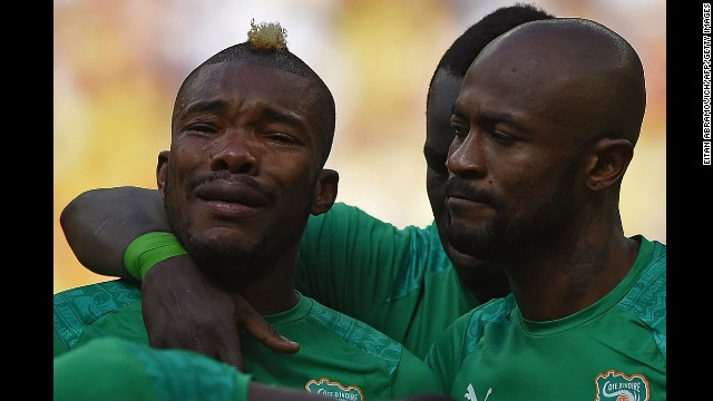 Serey Die cries during the national anthem before the match.