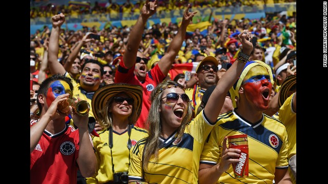 Colombia fans cheer before the start of the match.