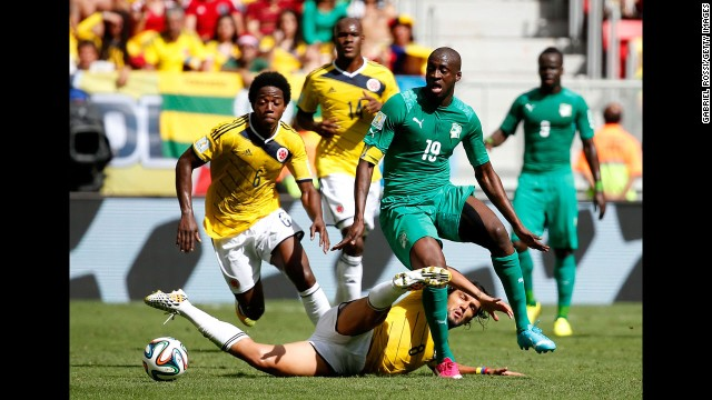 Aguilar slides to tackle Yaya Toure of the Ivory Coast.