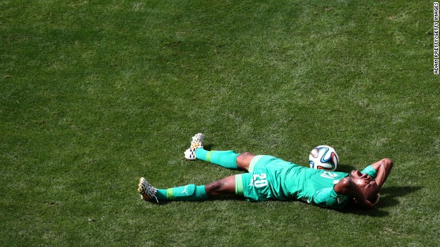 Serey Die of the Ivory Coast reacts on the ground during the match.