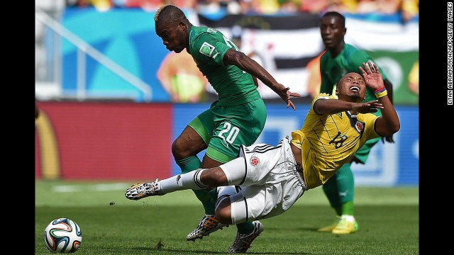 Serey Die fights off Colombian defender Juan Camilo Zuniga.