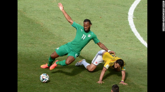 Ivory Coast forward Didier Drogba, left, competes with Colombian midfielder Abel Aguilar.