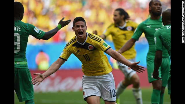 Colombian midfielder James Rodriguez celebrates after he headed in a corner kick for the first goal of the game.