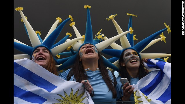 Uruguay fans cheer before the start of the match.