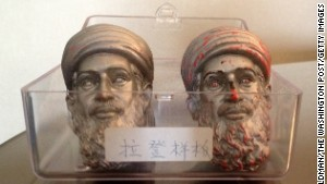 Seen here are two sample heads of the Osama bin Laden action figure doll.